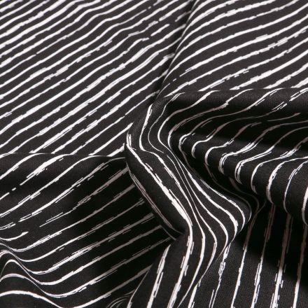 Tissu Coton imprimé Rayures irrégulières sur fond Noir - Par 10 cm