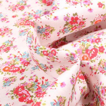 Tissu Popeline de coton Bouquet printanier rose sur fond Blanc
