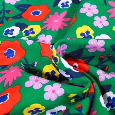 Tissu Jersey Coton Fleurs seventies vitaminés sur fond Vert vif