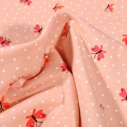 Tissu Jersey Coton Papillons et petits pois blanc sur fond Saumon