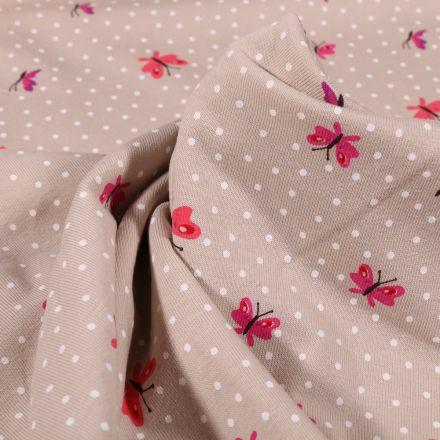 Tissu Jersey Coton Papillons et petits pois blanc sur fond Beige