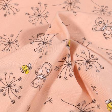Tissu Jersey Coton Pissenlit et papillons sur fond Rose saumon