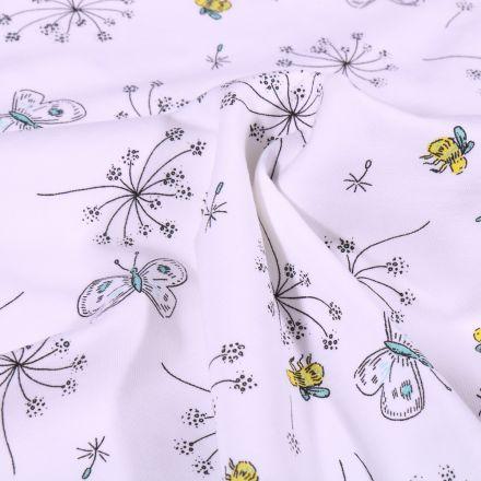 Tissu Jersey Coton Pissenlit et papillons sur fond Blanc