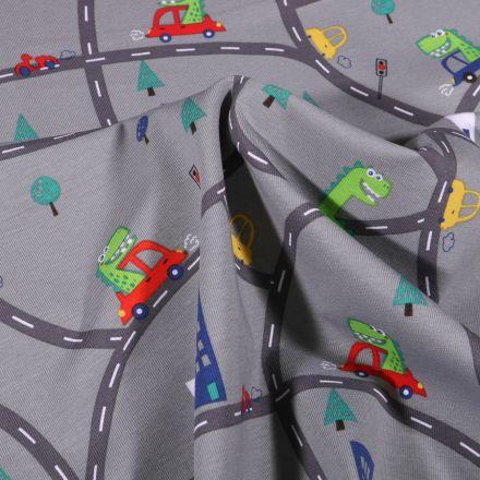 Tissu Jersey Coton Dinosaures en ville sur fond Gris
