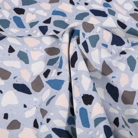 Tissu Jersey Coton Terrazzo bleu gris sur fond Bleu ciel