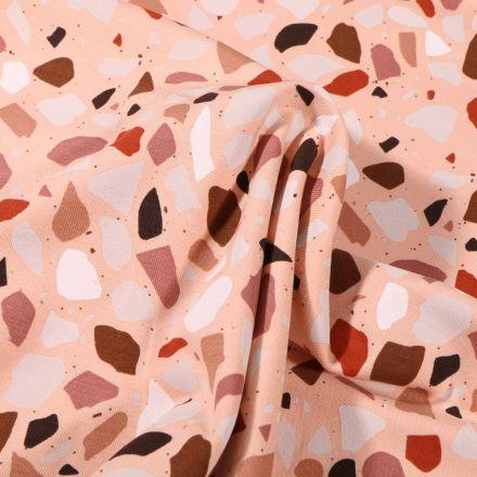 Tissu Jersey Coton Terrazzo blanc rouille sur fond Rose saumon