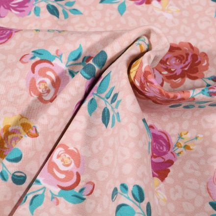 Tissu Jersey Coton Tâches léopard et fleurs colorées sur fond Rose pâle