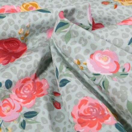 Tissu Jersey Coton Tâches léopard et fleurs colorées sur fond Vert menthe clair