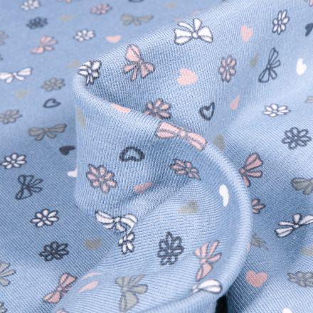 Tissu Jersey Coton Petits nœuds et cœurs sur fond Bleu layette