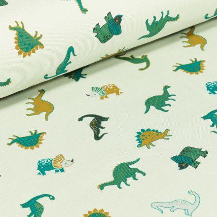 Tissu Jersey Coton Dinosaures verts et ocre sur fond Blanc
