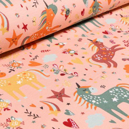 Tissu Jersey Coton Licornes étoiles et coeurs sur fond Rose saumon