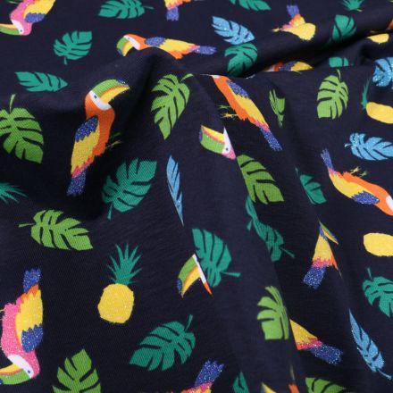 Tissu Jersey Coton Toucans pailletés, ananas et feuilles tropicales sur fond Bleu marine