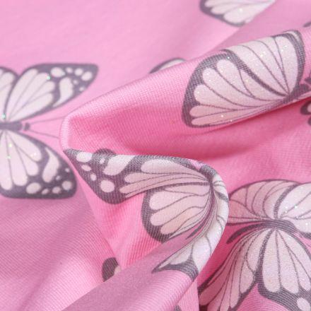 Tissu Jersey Coton Papillons et cœurs pailletés sur fond Rose