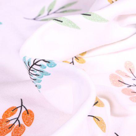 Tissu Jersey Coton Feuillages colorés et pailleté sur fond Blanc