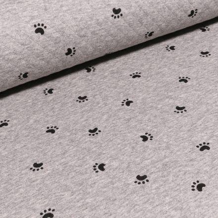 Tissu Sweat matelassé Empreintes sur fond Gris chiné