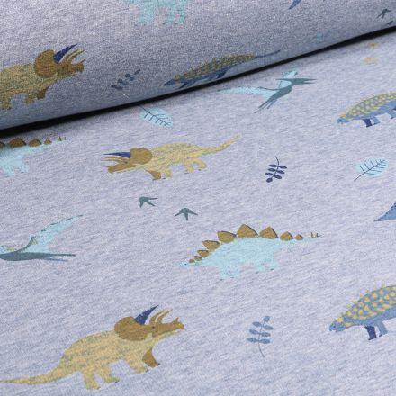 Tissu  Sweat envers minky Dinosaures et feuilles sur fond Bleu chiné
