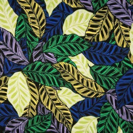 Tissu Jersey viscose imprimé Feuilles jaunes, vertes et bleues sur fond Noir - Par 10 cm