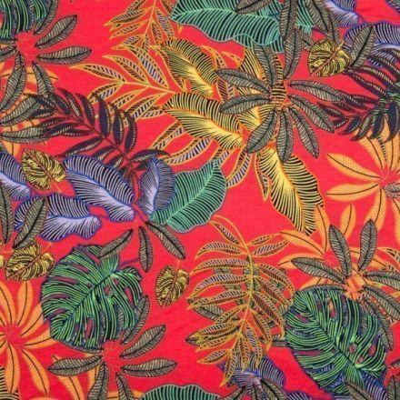 Tissu Jersey viscose imprimé  Feuillages exotiques jaunes,verts et bleus sur fond Rouge - Par 10 cm
