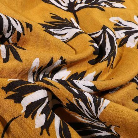 Tissu Viscose texturé Feuilles noires et blanches sur fond Jaune moutarde - Par 10 cm