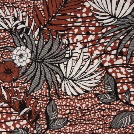 Tissu Viscose toucher crêpe imprimé  Feuilles de palmier noires et blanches sur fond Terracotta - Par 10 cm