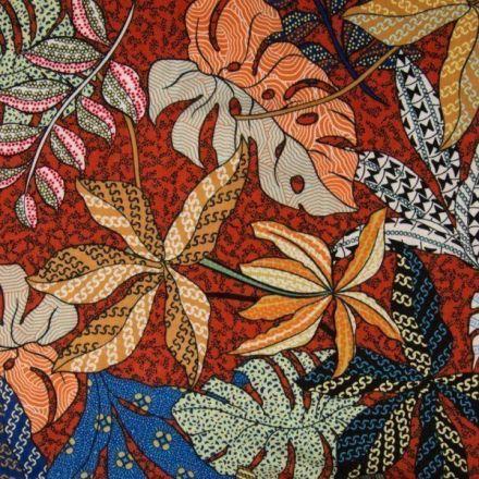 Tissu Viscose texturé Feuillages aborigènes sur fond Brique - Par 10 cm