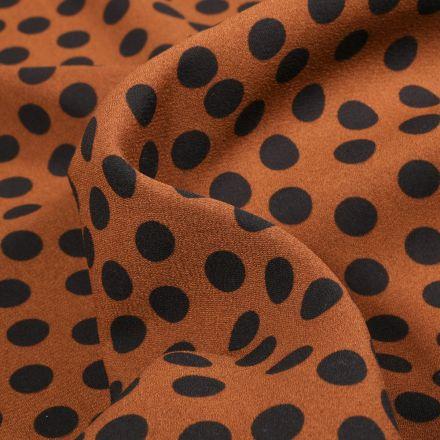 Tissu Crêpe Georgette Pois noirs sur fond Brique