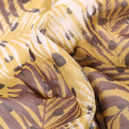 Tissu Mousseline Crépon  Feuilles et pois sur fond Ocre