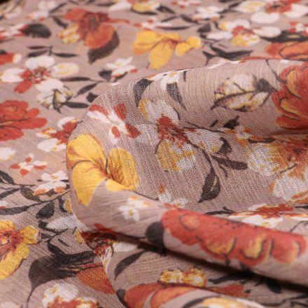 Tissu Mousseline Crépon Fleurs orange et jaune sur fond Beige