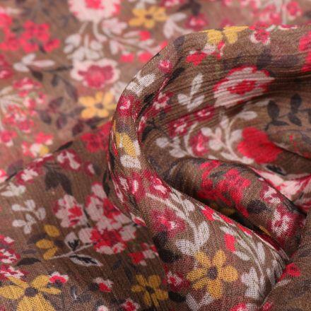 Tissu Mousseline Crépon Fleurs jaunes rouges et blanches sur fond Marron