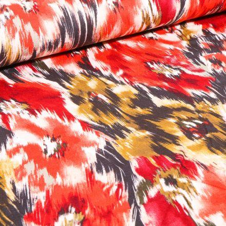 Tissu Jersey Viscose  Motifs abstraits colorés sur fond Rouge