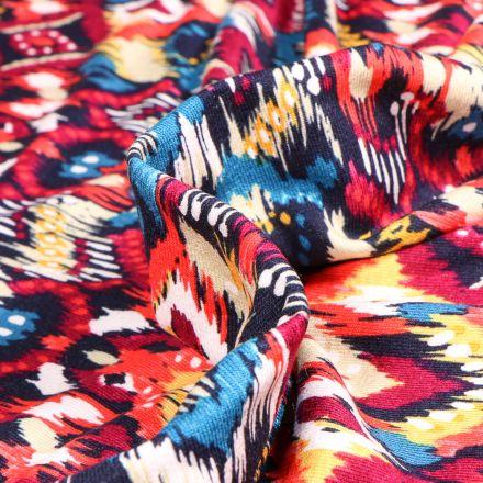 Tissu Jersey Viscose  Motifs ethniques colorés sur fond Rouge