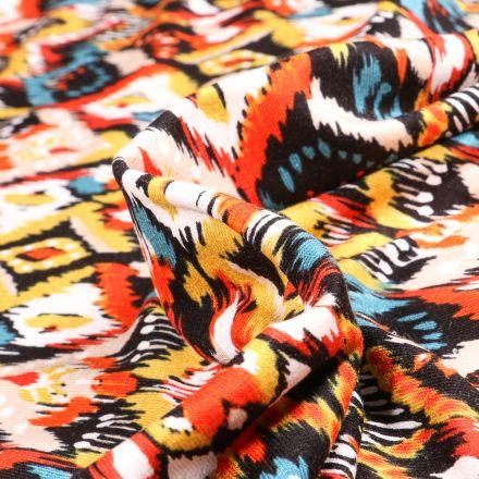 Tissu Jersey Viscose  Motifs ethniques colorés sur fond Orange