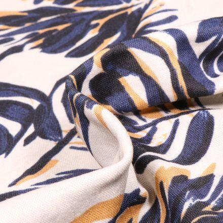 Tissu Jersey Viscose aspect maille Feuilles noires et bleues sur fond Blanc cassé