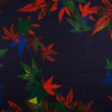 Tissu Caban Laine Feuilles orange et vertes sur fond Bleu marine - Par 10 cm