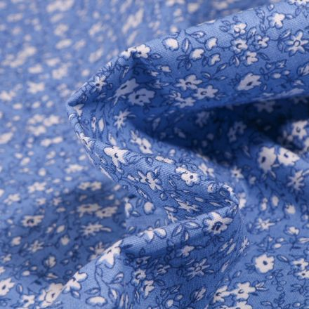 Tissu Coton imprimé Arty Léonie blanc sur fond Bleu - Par 10 cm