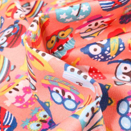 Tissu Coton enduit Hiboux summer sur fond Corail