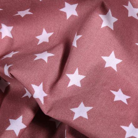 Tissu Coton imprimé Grandes étoiles blanches sur fond Vieux rose - Par 10 cm