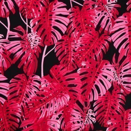 Tissu Coton Satiné Feuilles de Monstera Rouges et roses sur fond Noir - Par 10 cm