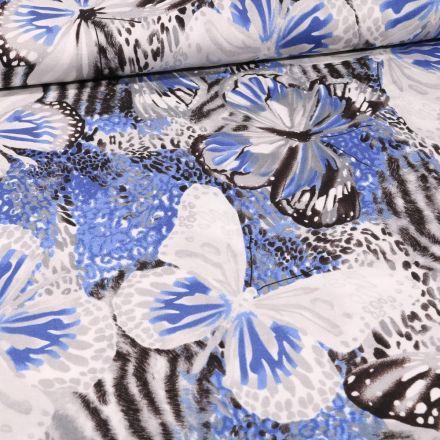 Tissu Jersey Viscose Papillons zébrés sur fond Bleu - Par 10 cm