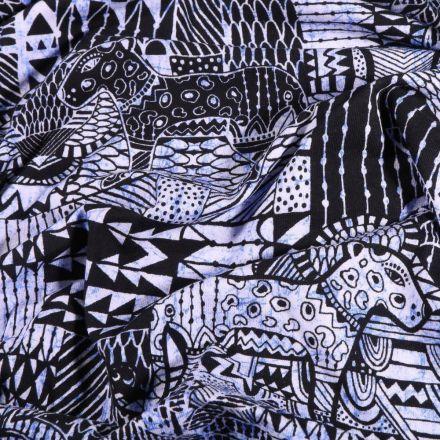 Tissu Jersey Coton Motifs ethniques panthère sur fond Bleu - Par 10 cm