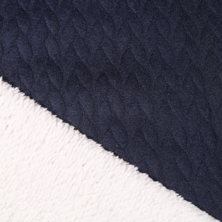 Tissu Sweat envers mouton Pétales sur fond Bleu marine - Par 10 cm