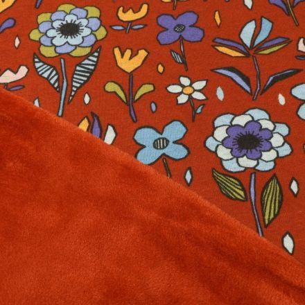 Tissu Sweat envers minky  Grandes fleurs colorées sur fond Brique - Par 10 cm