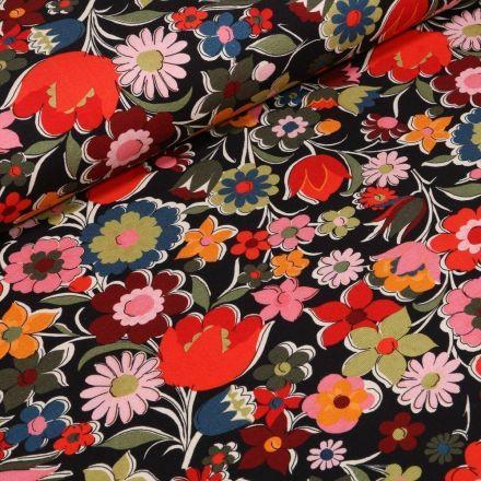 Tissu Jersey Coton Fleurs printanières sur fond Noir - Par 10 cm