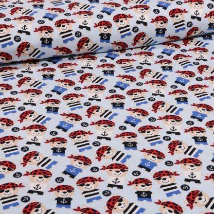 Tissu Jersey Coton Teddy pirates sur fond Bleu ciel - Par 10 cm