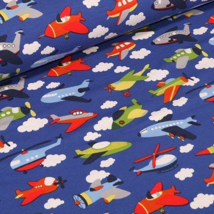 Tissu Jersey Coton Transports aériens sur fond Bleu roi - Par 10 cm