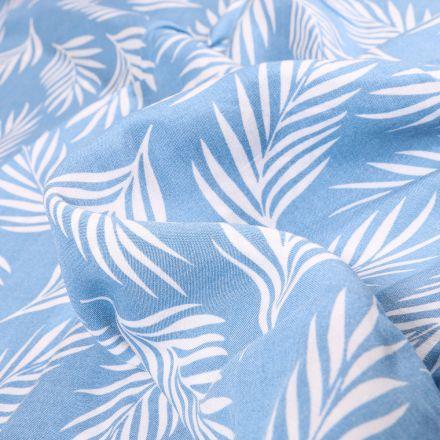 Tissu Viscose Popeline Feuilles de palme blanches sur fond Bleu ciel