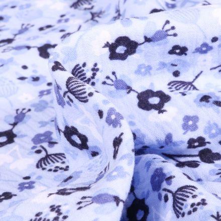 Tissu Double gaze imprimé Fleuris sur fond Bleu ciel