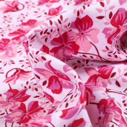 Tissu Coton imprimé LittleBird Camaïeu de Fleurs rose sur fond Blanc