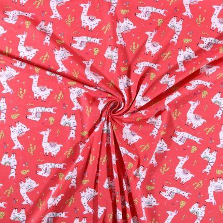 Tissu jersey coton  Lamas et cactus sur fond Rouge - Par 10 cm
