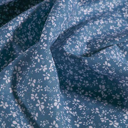 Tissu Coton imprimé Arty Petites fleurs blanches sur fond Bleu indigo - Par 10 cm
